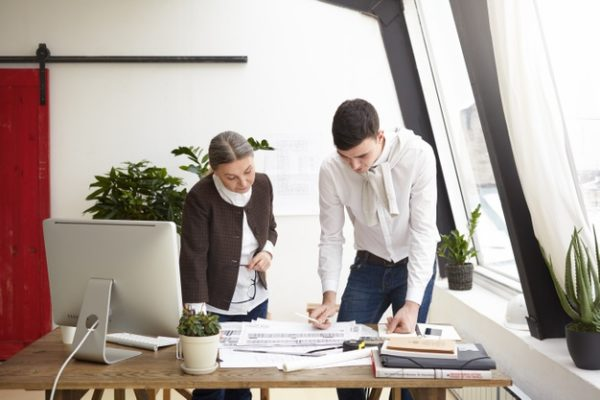 portrait-serious-creative-professional-designers-young-man-senior-woman-working-project-standing-office-desk-creating-interior-designs-residential-houses-commercial-property_344912-1630